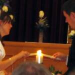 Aaron and Diane Traffas lighting the unity candle